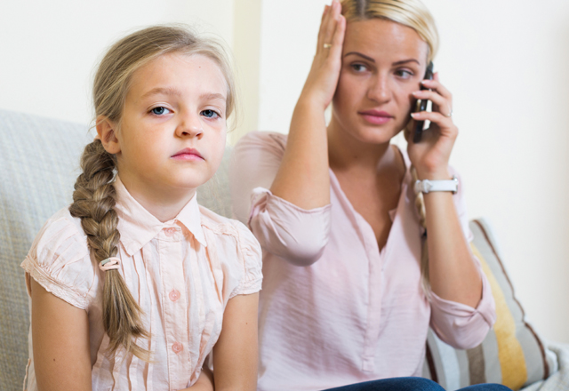 sick child with her mother in the phone