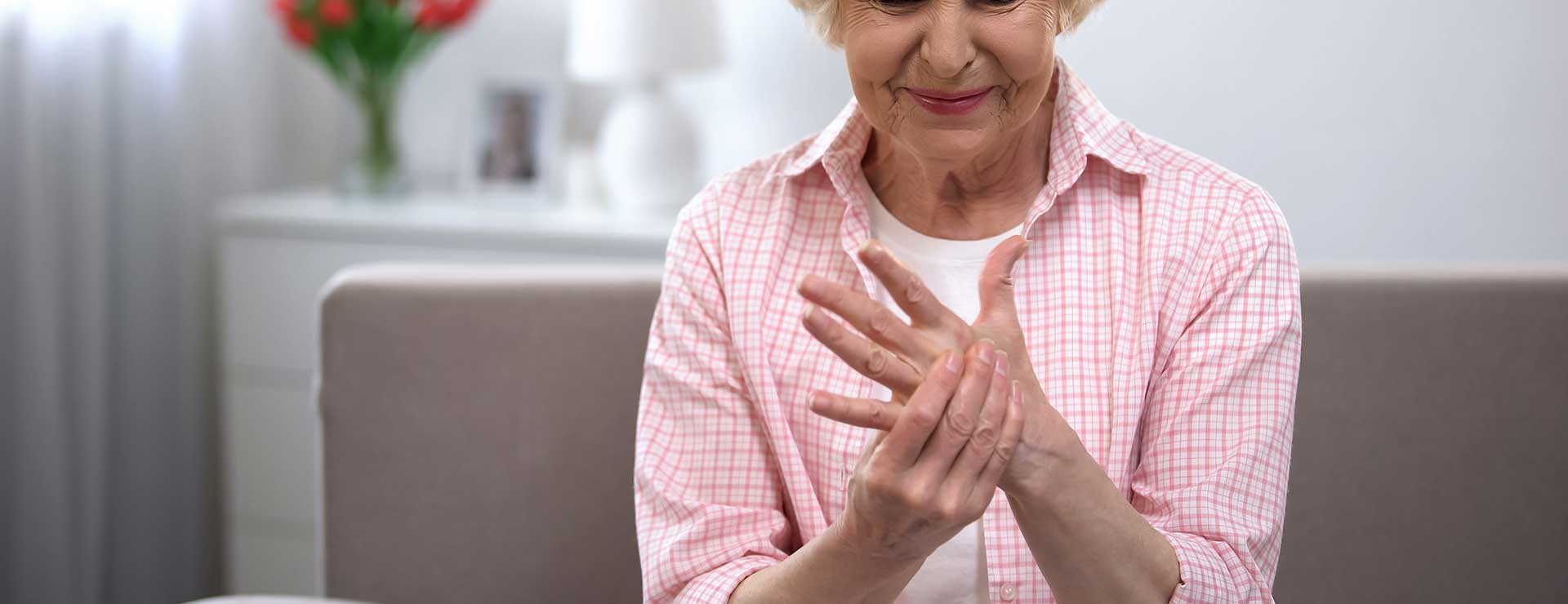 Women experiencing pain from osteoarthritis in hand