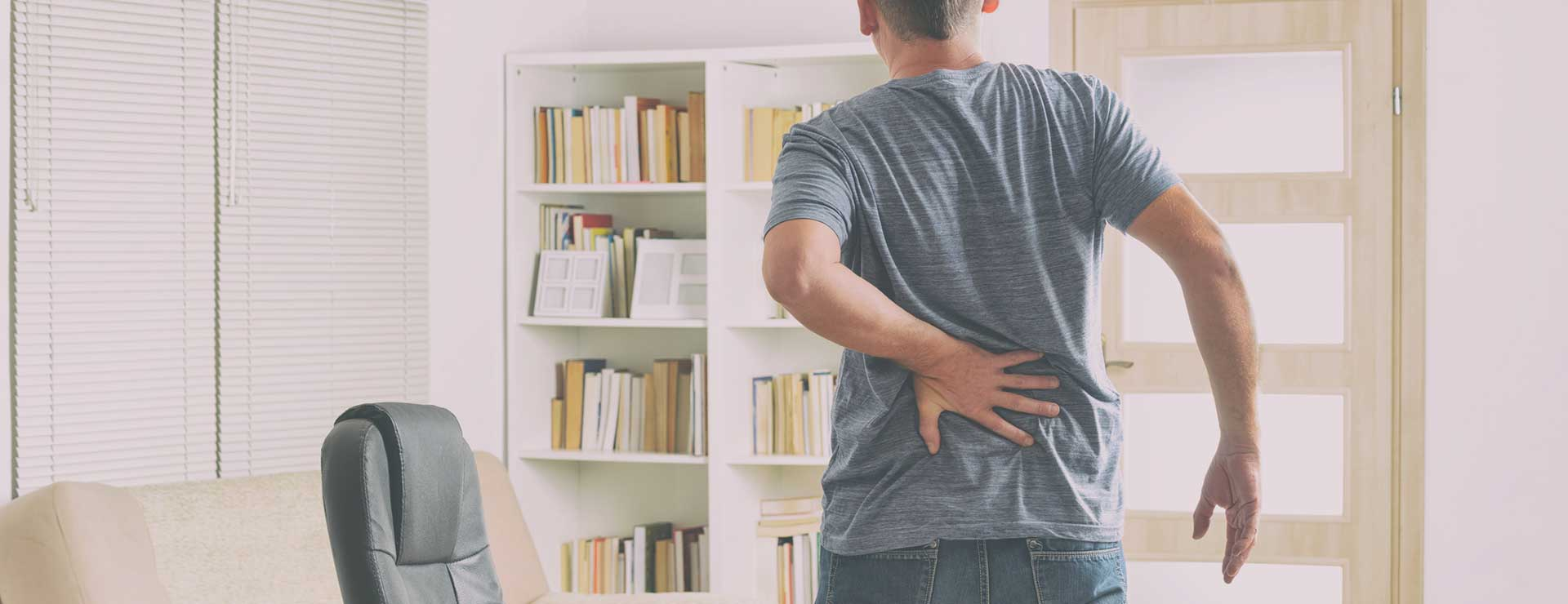 Man experiencing back pain after standing up