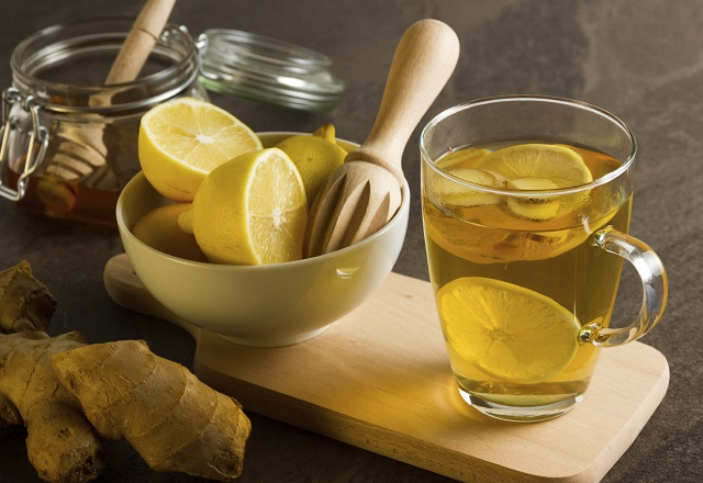 a bowl of lemons with ginger