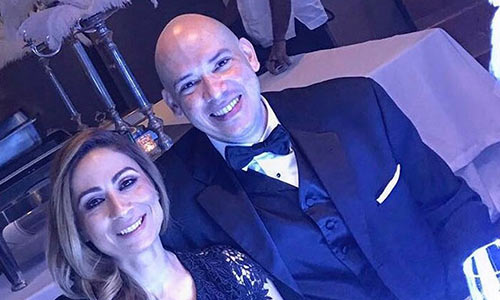 Pedro and his spouse at a formal event.
