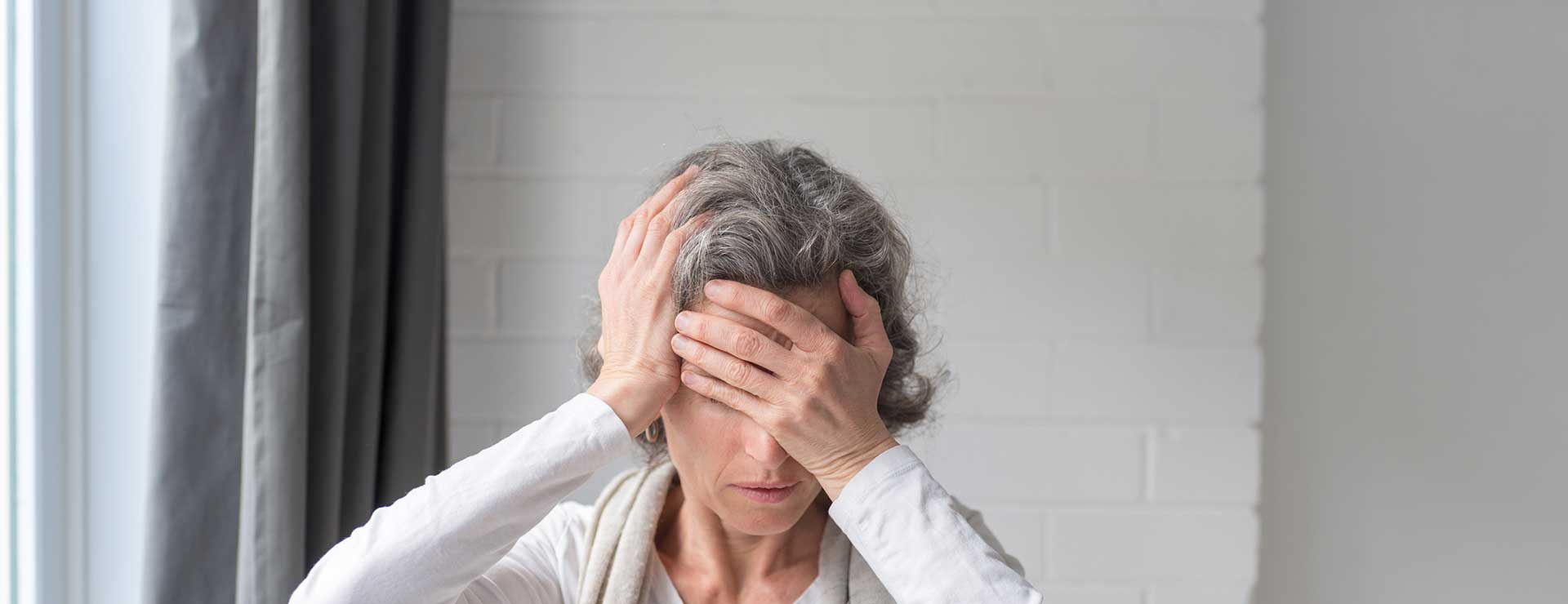 Older woman holding face in pain