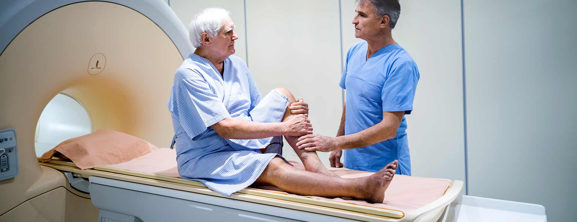 a man prepares to undergo a medical scan