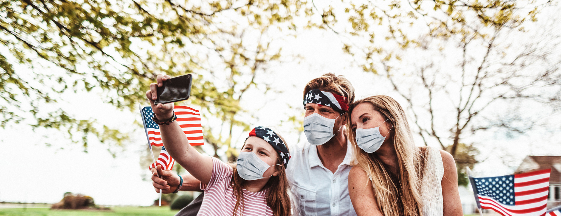 A family celebrating the 4th of July with masks on