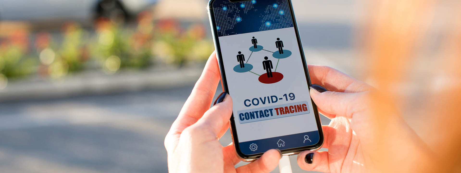 woman using contact tracing app on phone