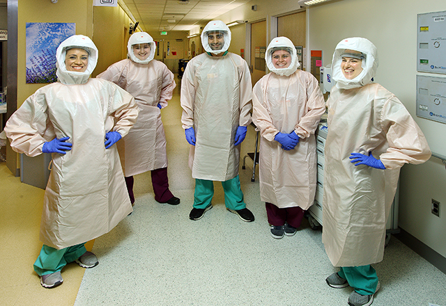 A team of recovery specialists wear PPE.