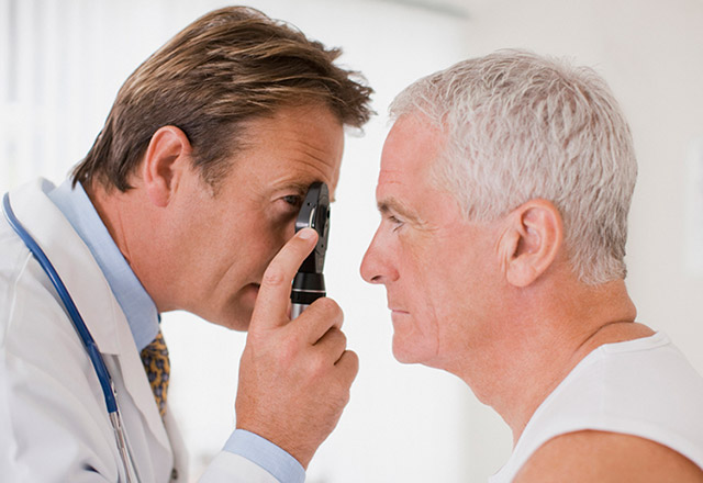 Eye doctor examines a patient's vision