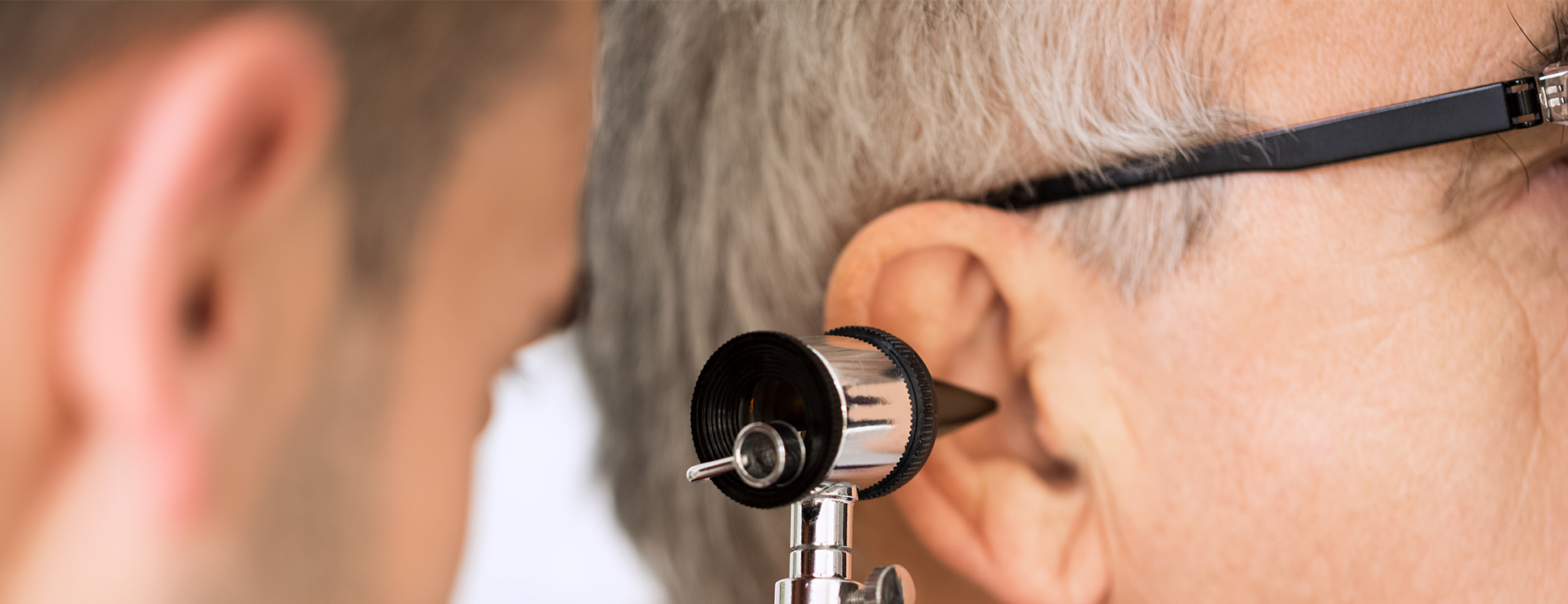 doctor looking in a patient's ear