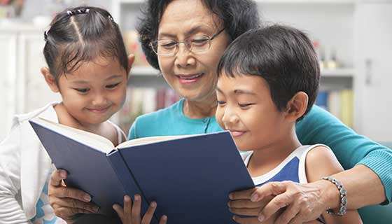 grandmother reading to children