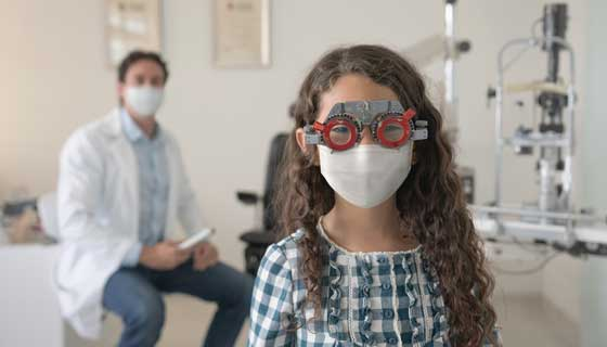 elderly man with glasses laughing