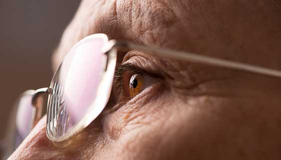elderly woman eye with glasses