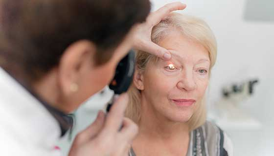 senior women having eye looked at by doctor