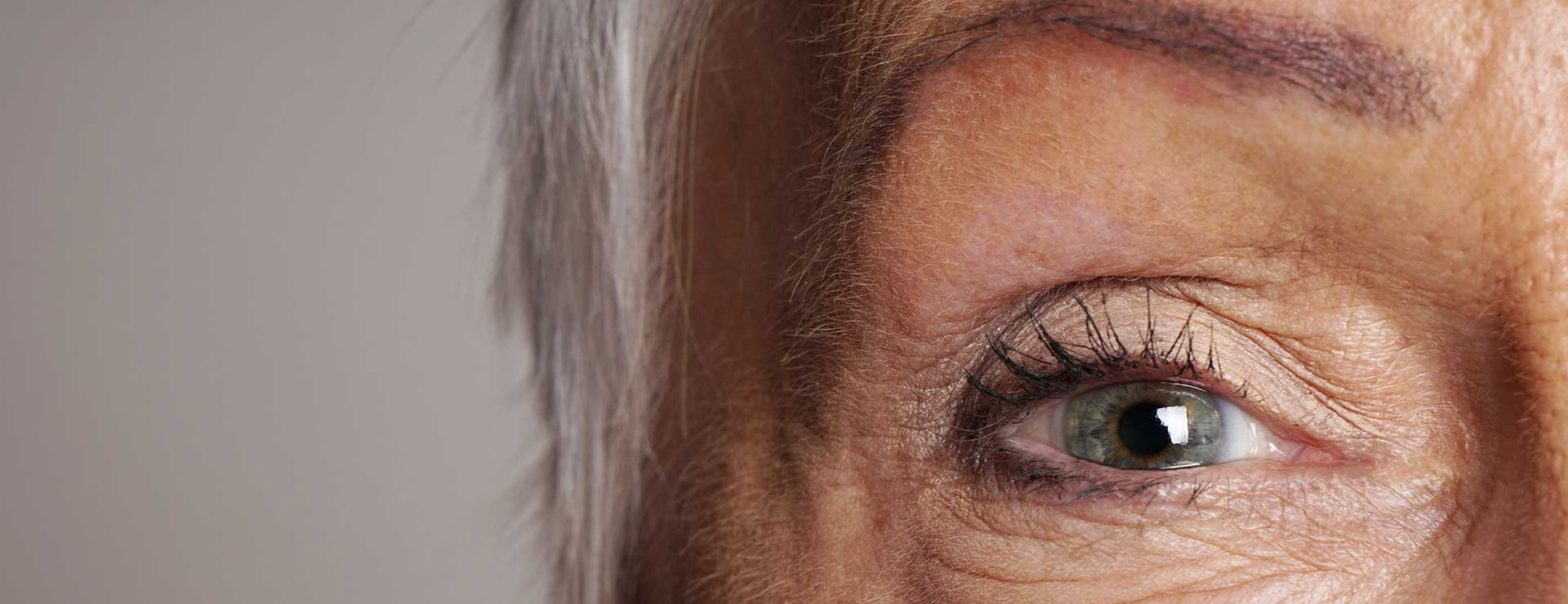 closeup of senior woman green eye