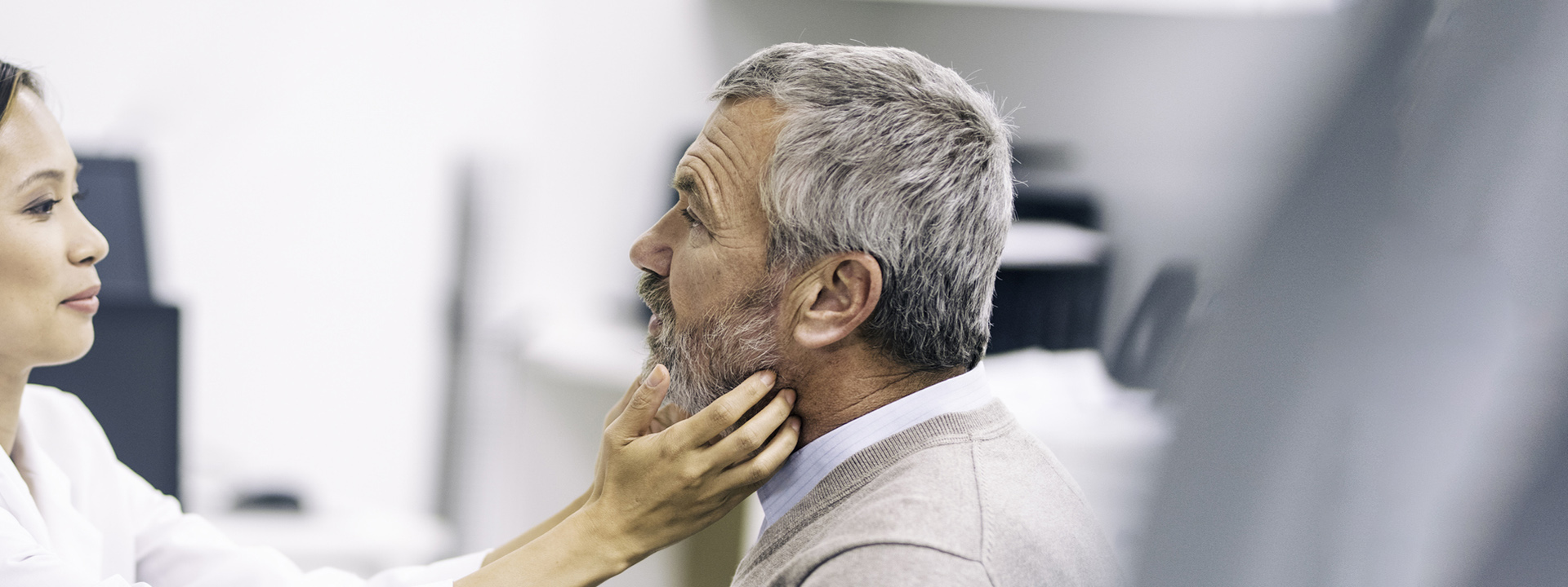 doctor checking patient's neck