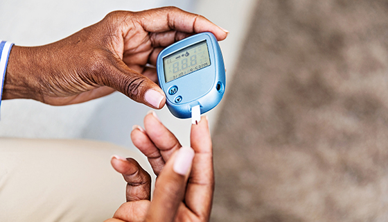 diabetes and heart disease - woman testing blood sugar