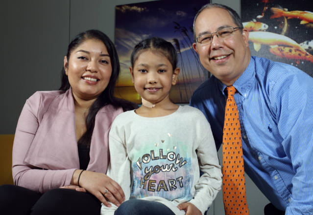 Stephanie Brown with her daughter, Maiyah, and pediatric cardiologist William Ravekes.