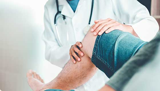 Doctor examining a patient's knee