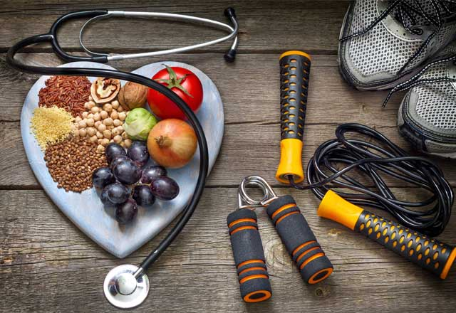 Vegetables and exercise equipment to represent a healthy lifestyle
