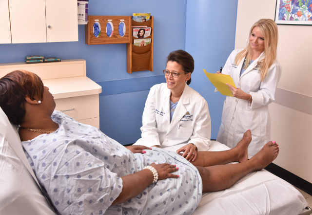 Dr. Carol Morris talking to a patient