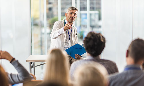 Doctor speaking at a conference