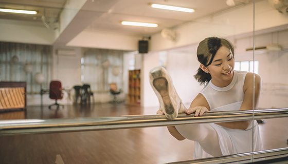 Ballet dancer practicing in studio