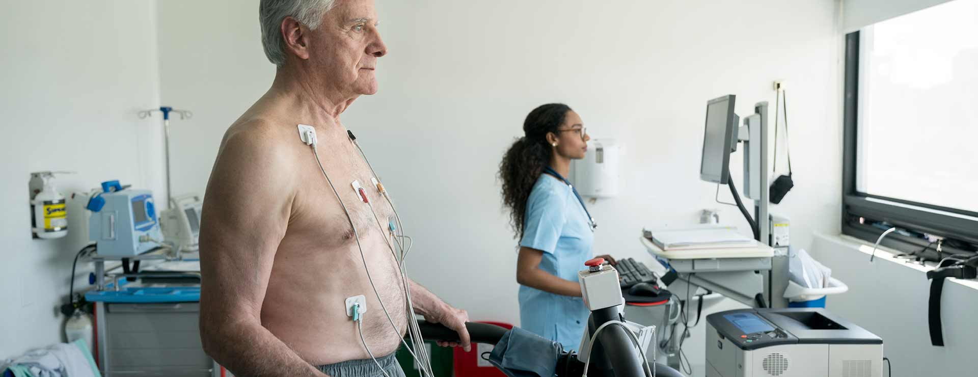 A senior man undergoes a stress echocardiogram.
