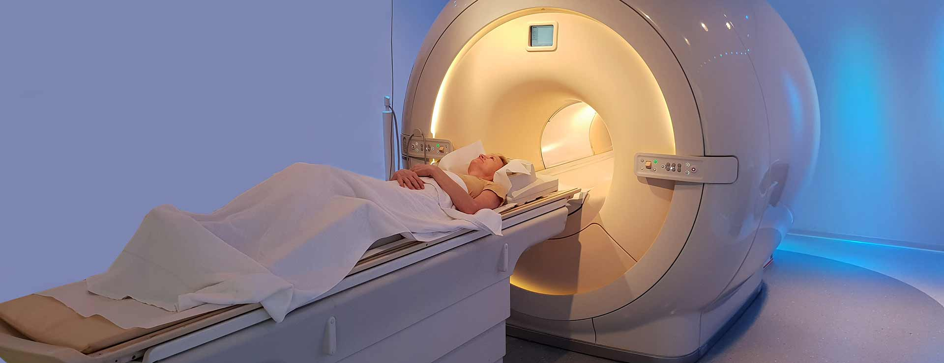 A patient undergoes a CT scan.
