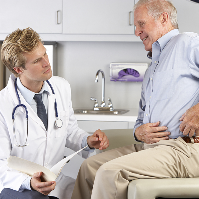 Male patient listens to doctor's instructions""
