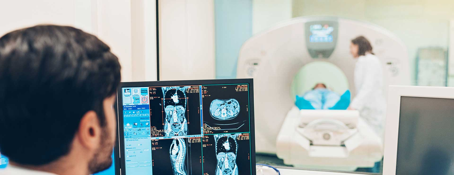Doctors using a MRI machine to scan patient
