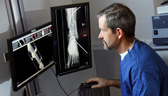 Dr. James Ficke looking at foot X-Rays before a surgery