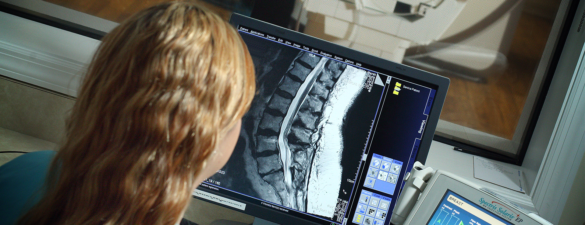 woman looking at mri screen