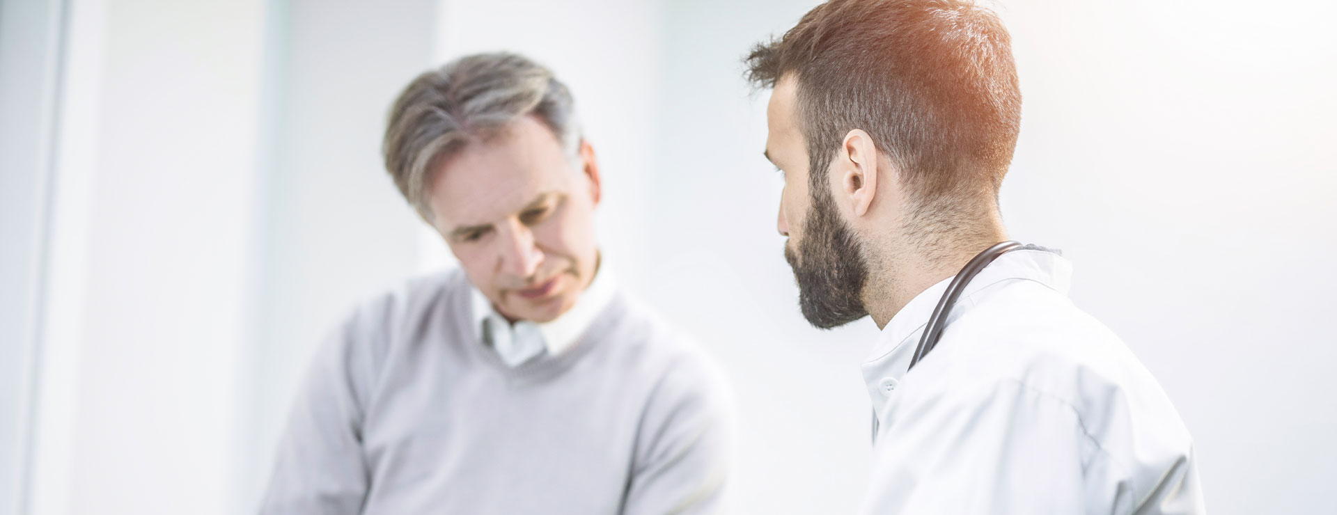 man with doctor at a consultation