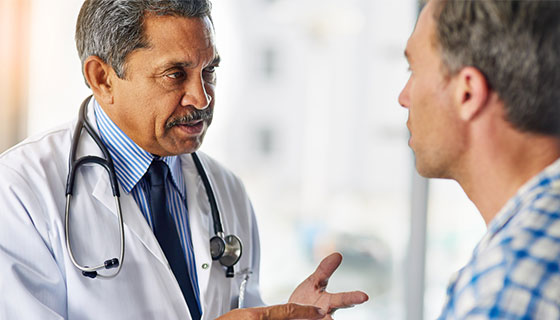 doctor consulting with male patient