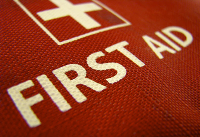 first aid sign printed on red canvas