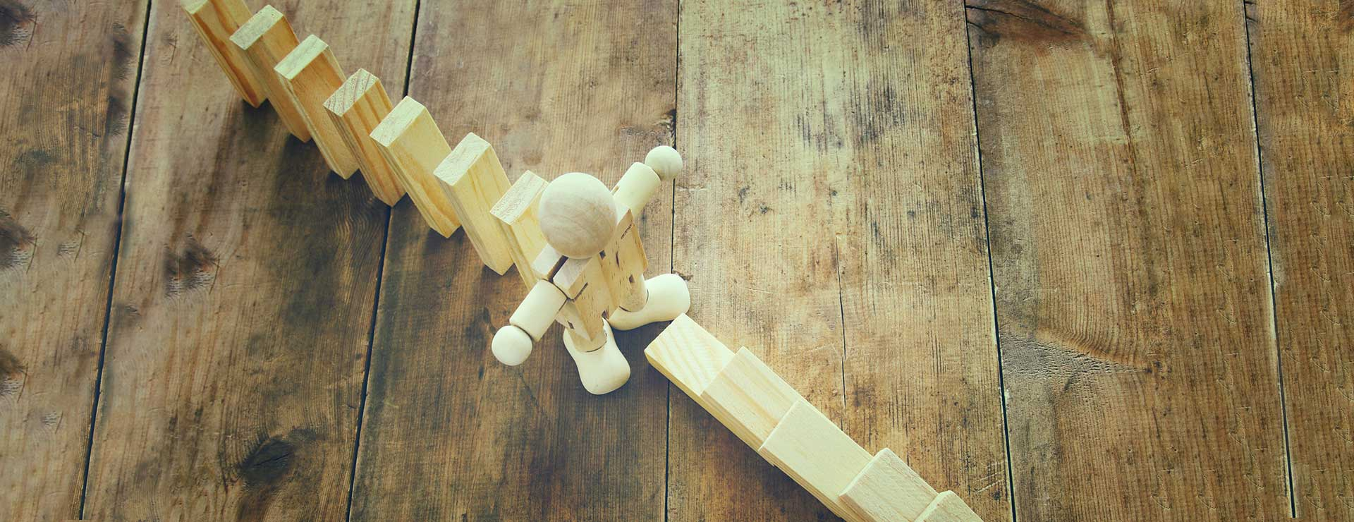 A wooden dummy stopping the domino effect
