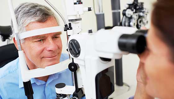 Older man undergoing an eye exam