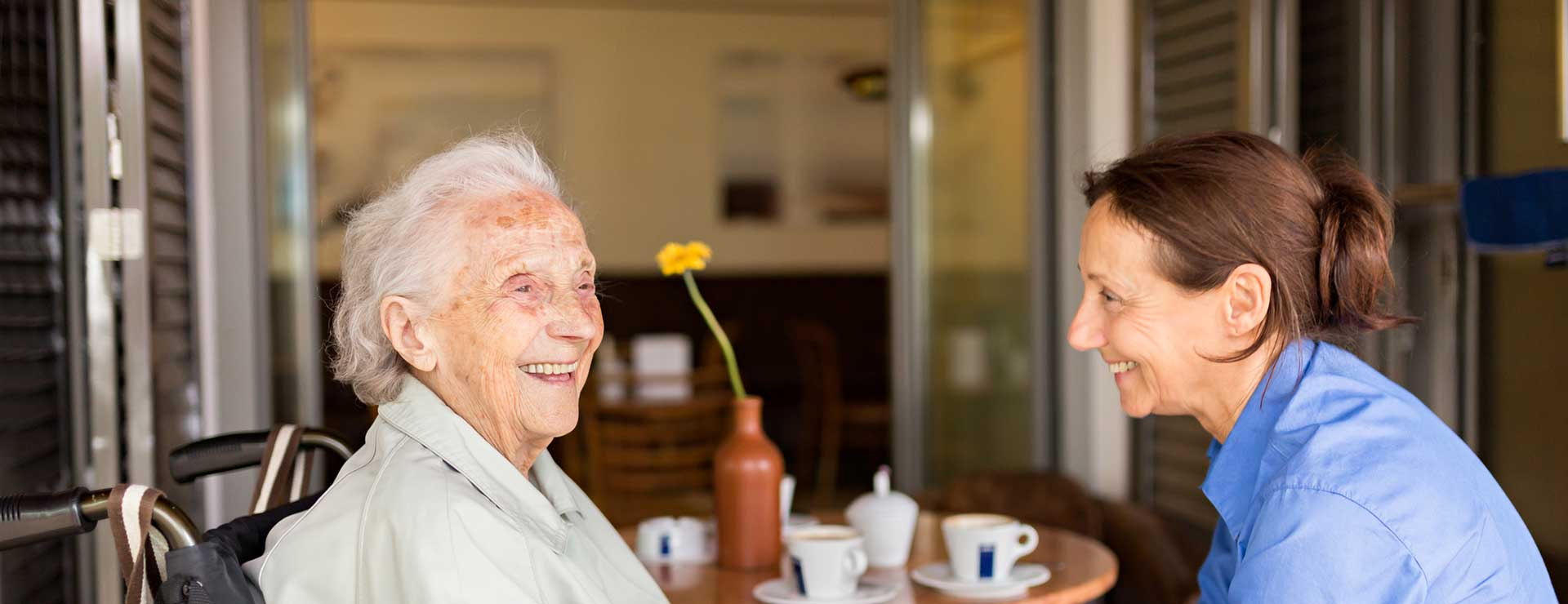 A senior woman at home with her caregiver