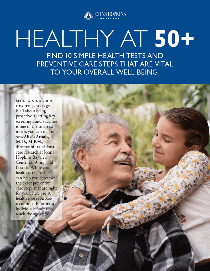 The cover of the Healthy at 50-plus guide, featuring a young girl hugging her grandfather.