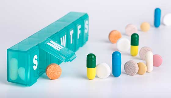 Pill organizer and a line of pills