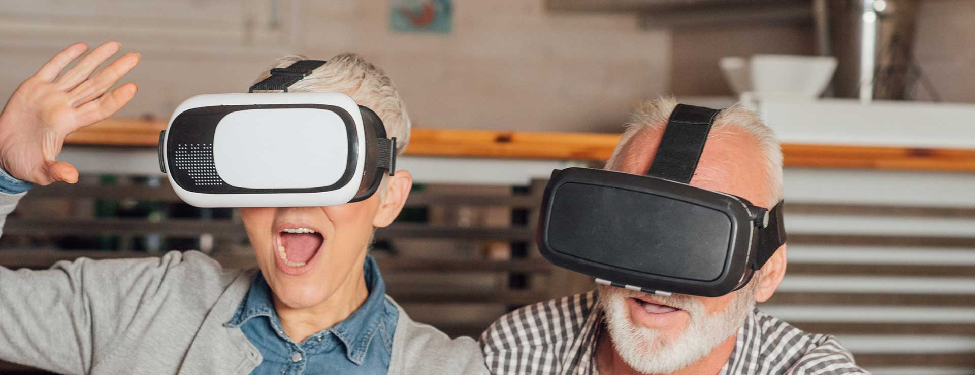 An old couple using virtual reality glasses