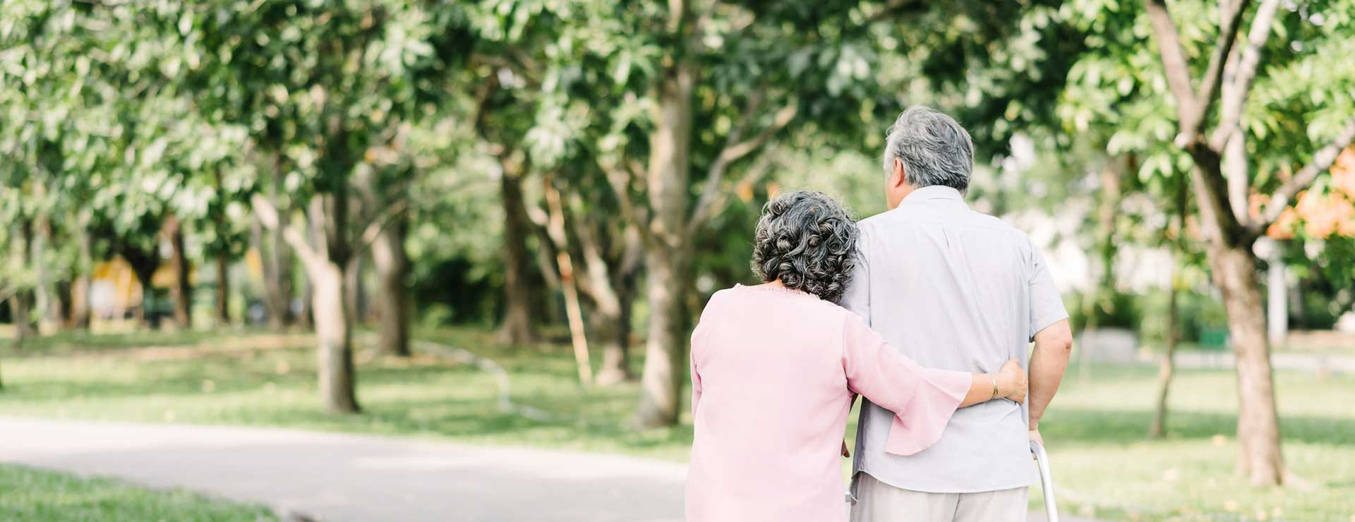 A senior couple walking in the park