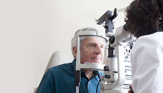 senior man receiving eye exam
