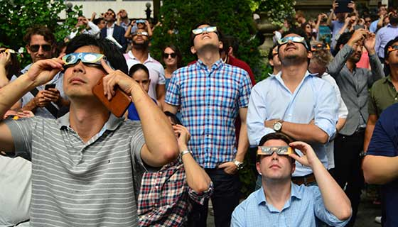 People watching solar eclipse while wearing special glasses