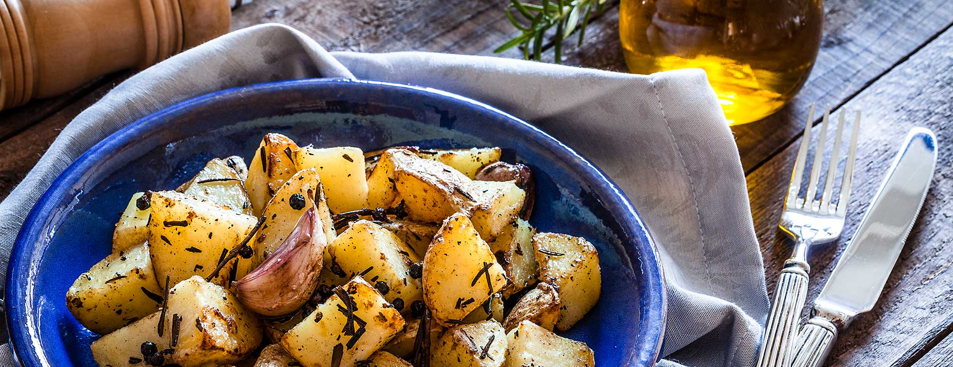 A dish of herb roasted potatoes.