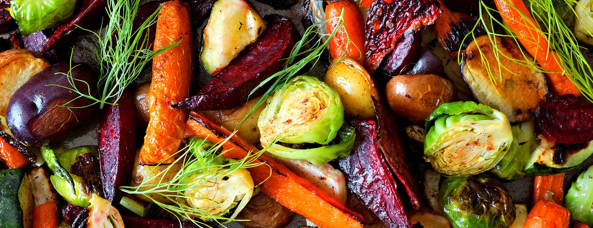 A colorful close up of roasted vegetables.