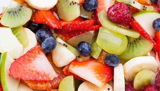 A close up of assorted cut fruits.