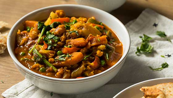 A bowl of vegetable curry.