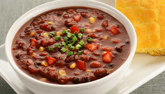 Bowl of chili with cornbread