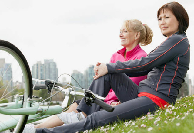 women stretching before a bike ride