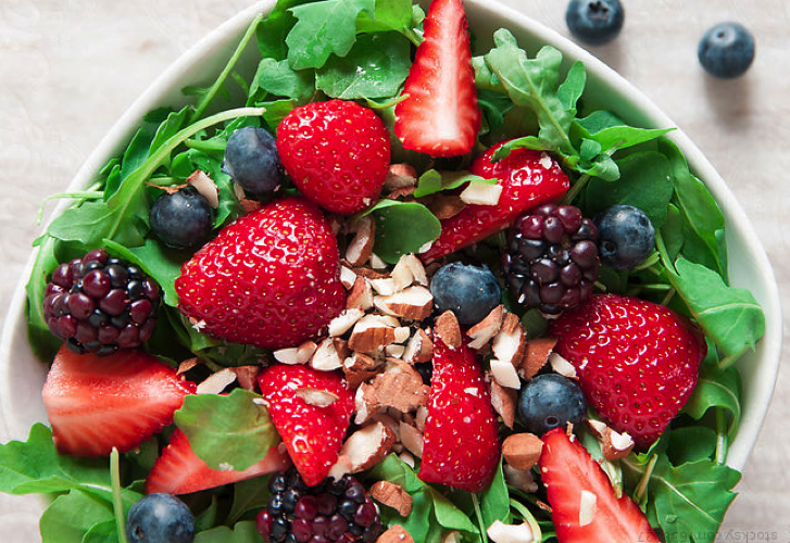 Salad with strawberries, blueberries and blackberries